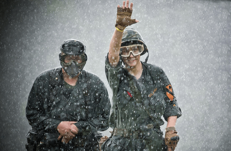 Two Guys Playing Airsoft In The Rain